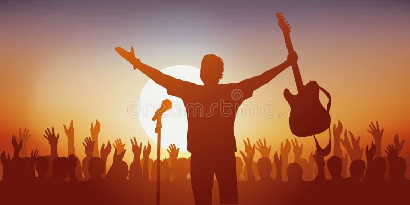 Symbol des Idols, wenn ein Rocksänger seine Fans grüßt lizenzfreie stockfotografie