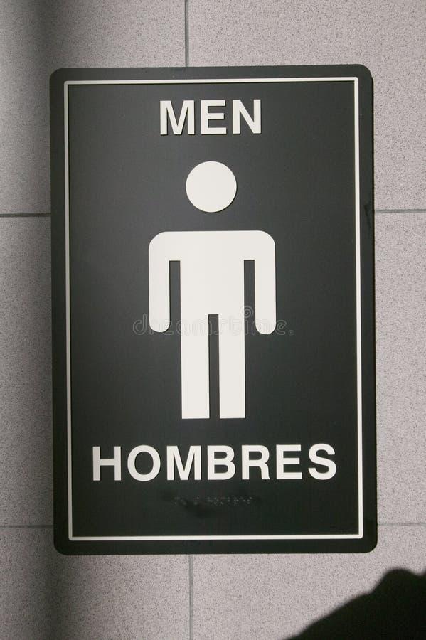 Symbol dla mężczyzna, hombres, przed lotniskową łazienką zdjęcia stock