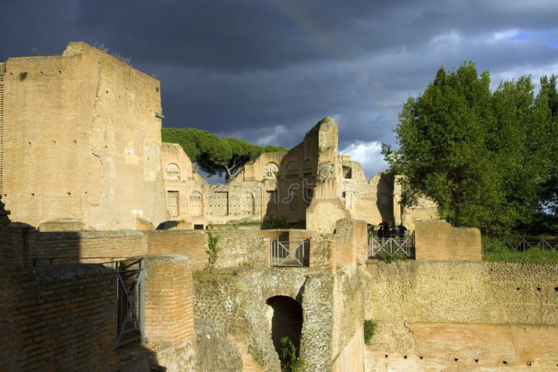 Palatine hill Rome Italy archaeology the antiquity of the excavations rainbow stormy sky stock photography