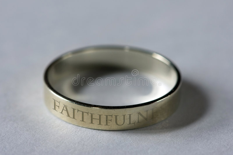 Symbol of Faithfulness. Wedding rings - symbols of faithfulness stock photography