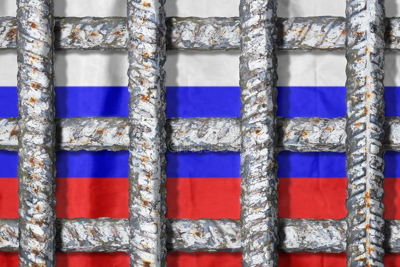 Symbol of freedom oppression in Russia. Prison grate on the russian flag background. Symbol of oppression of freedom in Russia. Crossing metal bars of the prison stock photography