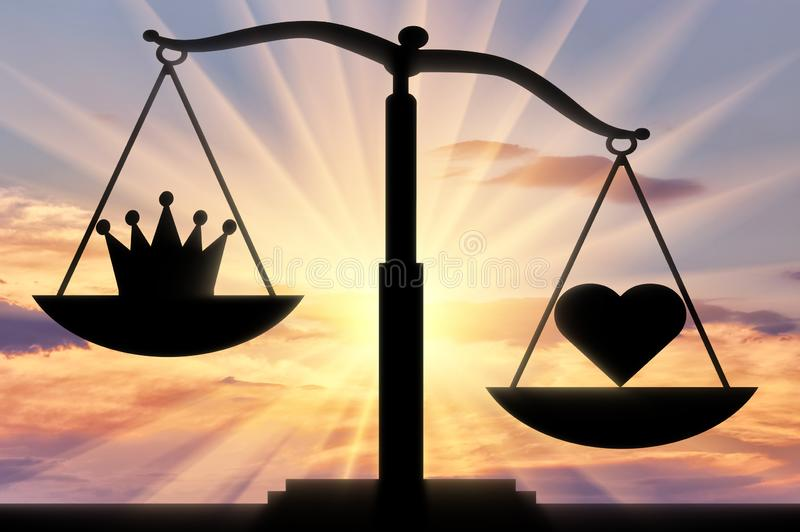 Symbol of the heart Altruism takes priority over the symbol of the crown of egoism on the scales of justice stock photography