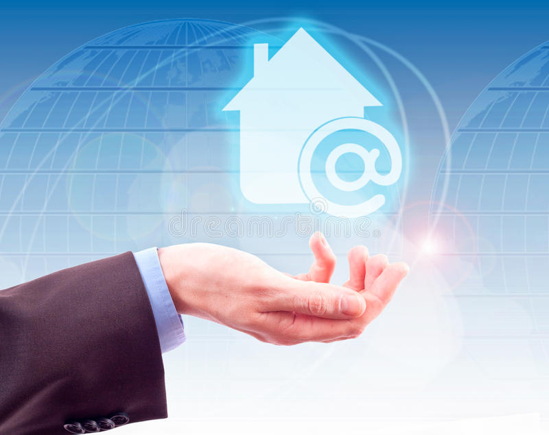Symbol Home Internet. Businessman holding his hand under the symbol Home Internet in the background of world map stock photo