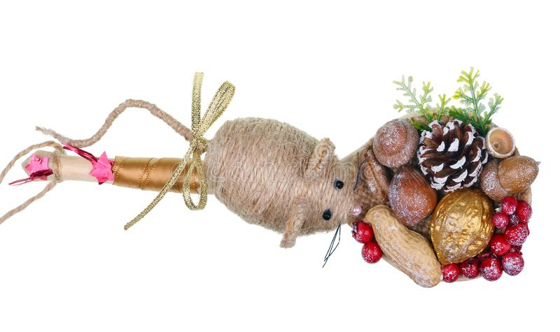 The symbol of 2020 - a homemade Mouse on wooden spoon- made from a rope  berries nuts and cone  isolated macro stock photo