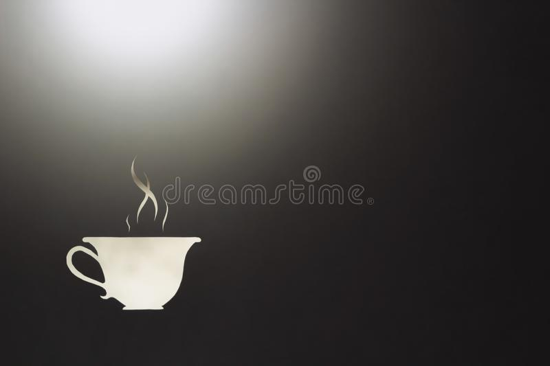 Symbol of hot drink medicine for colds in the rays of the rising sun. White cup with hot coffee in the early foggy morning in the rays of the rising sun and mist royalty free stock images