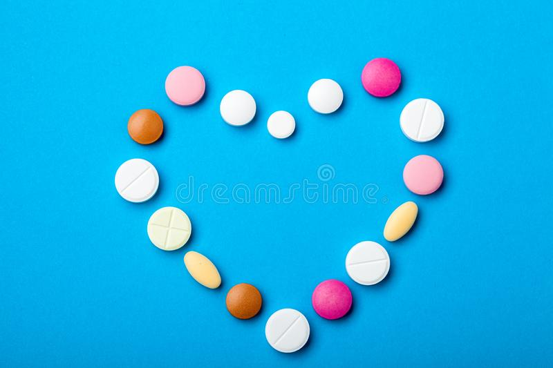 Symbol of love heart of multicolored tablets. royalty free stock image