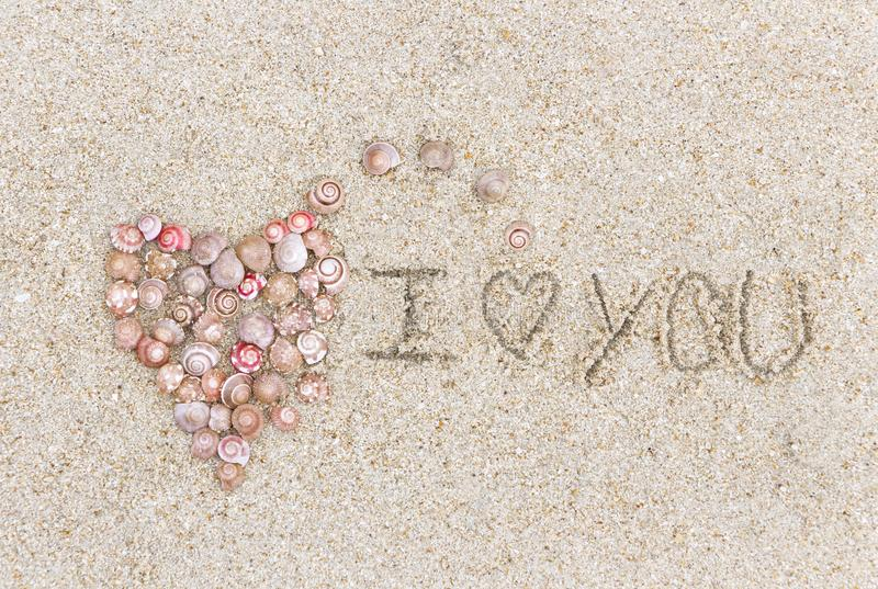 A symbol of love made a Heart shape of the shell and the word lo stock photography