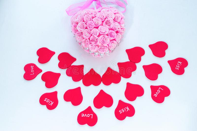 Symbol of love red paper hearts with labels and pink handmade decoration for wedding celebration for valentine day royalty free stock images