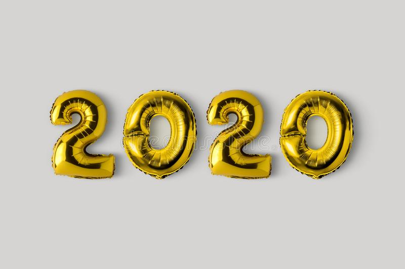 Symbol 2020 made of gold balloons. Minimal Christmas or New Year concept. Flat lay.  stock photos