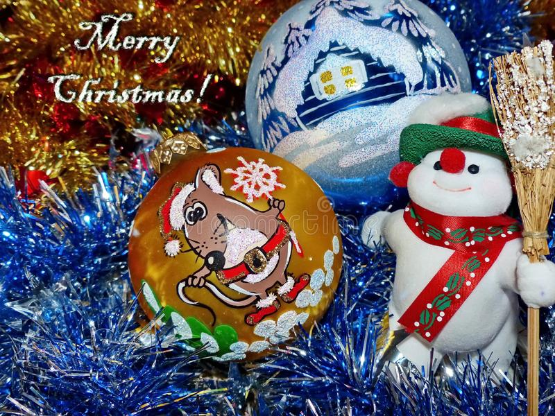 Symbol of new year 2020 Rat the white mouse of Christmas toys. Glass balls, snowman. The inscription `Merry Christmas!` royalty free stock images