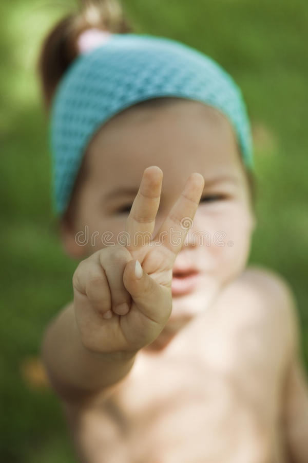Symbol of peace. A child shows his hands the symbol of peace stock images