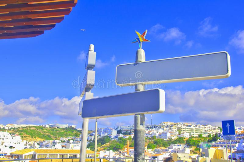 Symbol of Portugal, multicolored star, over the street signs royalty free stock photos