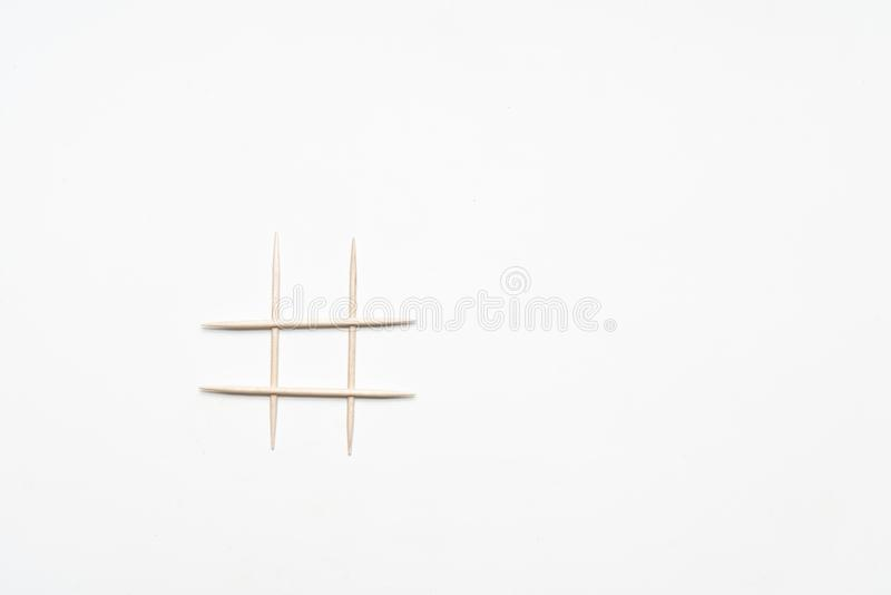 The symbol of the pound sign. On a white surface stock photo