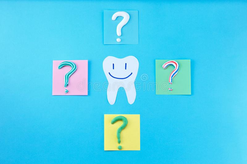 Symbol of question mark from toothpaste on blue background,. Toothpaste selection concept. Concept of dental care. Cleaning teeth stock image