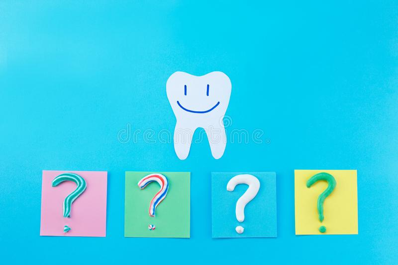 Symbol of question mark from toothpaste. Copy space for text. Toothpaste selection concept. Concept of dental care. Cleaning teeth stock photo