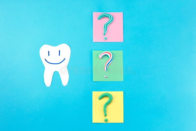 Symbol of question mark from toothpaste. Copy space for text. Toothpaste selection concept. Concept of dental care. Cleaning teeth royalty free stock photos