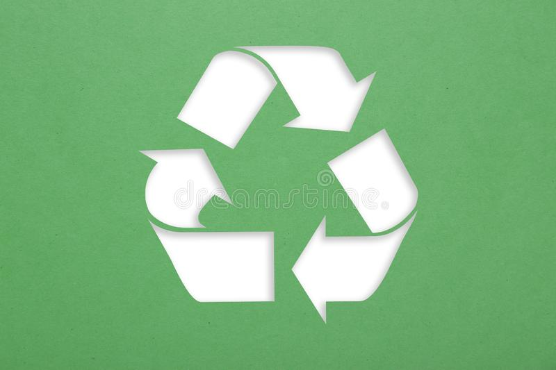 Symbol of recycling. On green cardboard background royalty free illustration