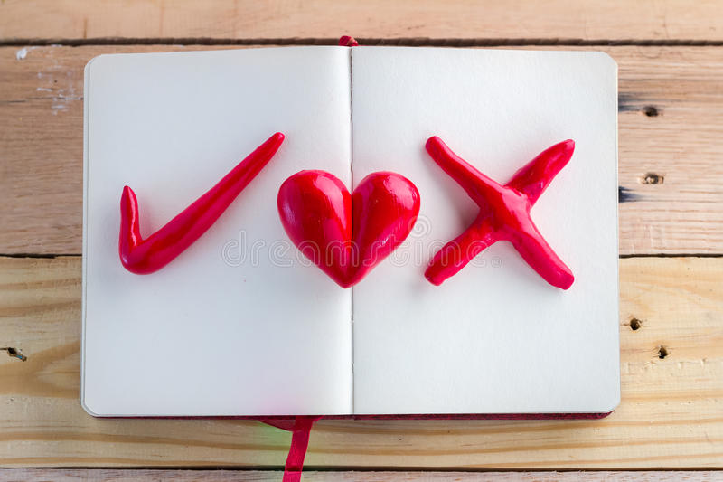 Symbol Of Right Wrong And Heart Red Color On Notebook Stock Image
