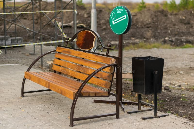 Symbol, Smoking area with benches and urns in the area under construction stock images