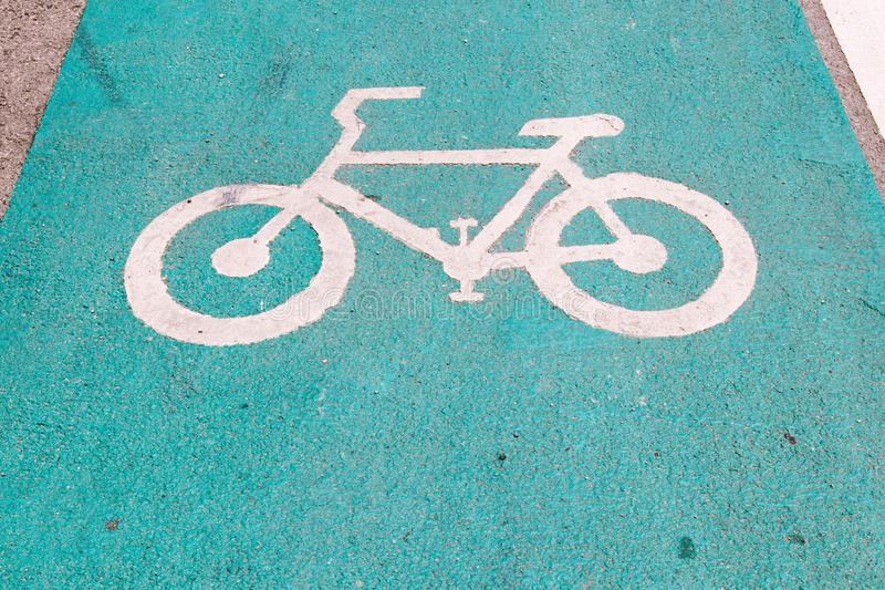 Symbol to indicate the road for bicycles.please share the road for bike. White bicycle road sign.traffic way symbol or sign on a bicycle stock images