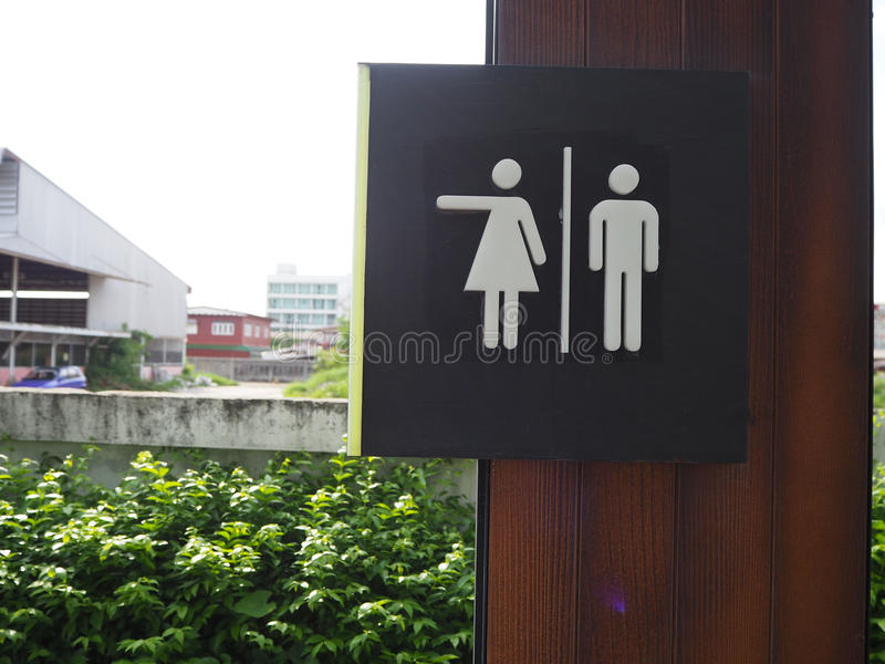 Symbol to tell the male and female toilets in the park,design symbol in the park , The way to the toilet in the park,The symbol o. F the garden,parking symbol stock image