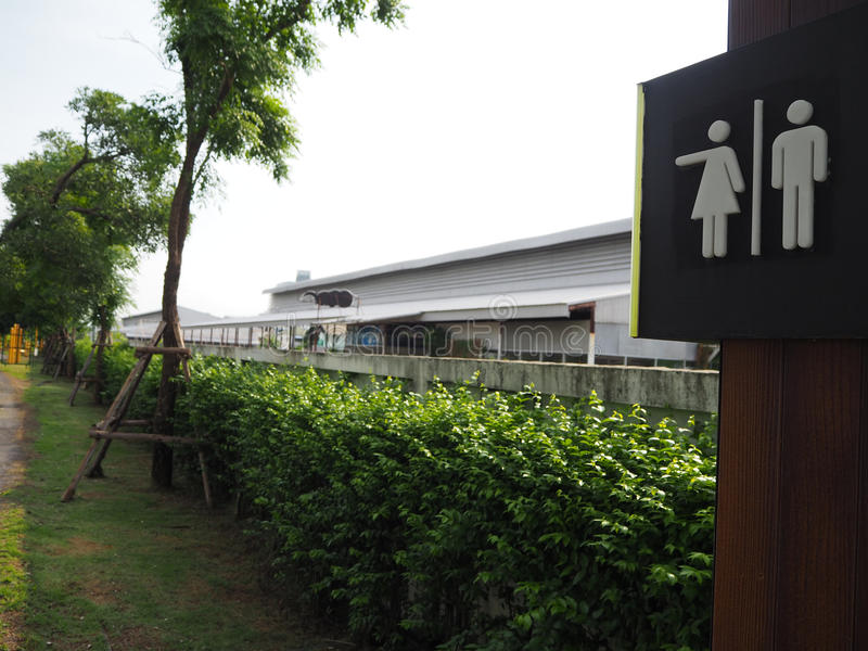 Symbol to tell the male and female toilets in the park,design symbol in the park , The way to the toilet in the park,The symbol o. F the garden,parking symbol stock photo
