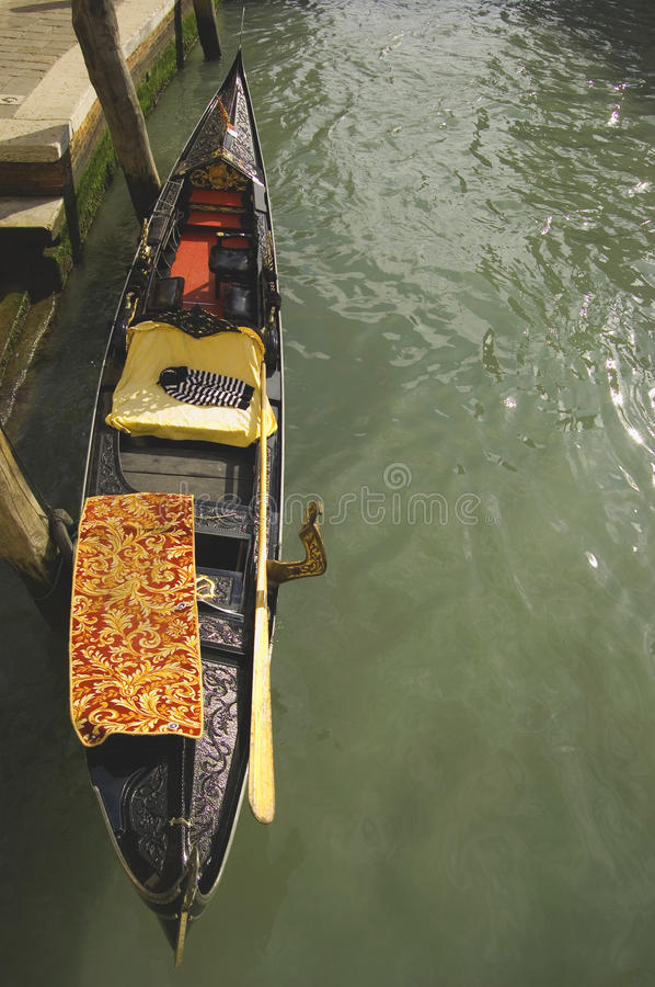 The symbol of Venice. A gondola in a venetian canal, venice stock image