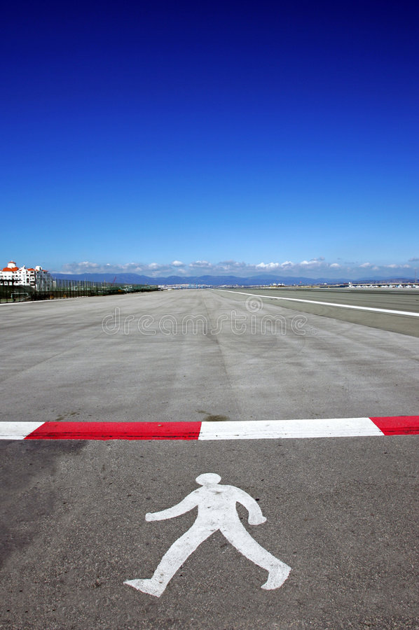 Symbol of walking man on runway at Gibraltar airport stock images