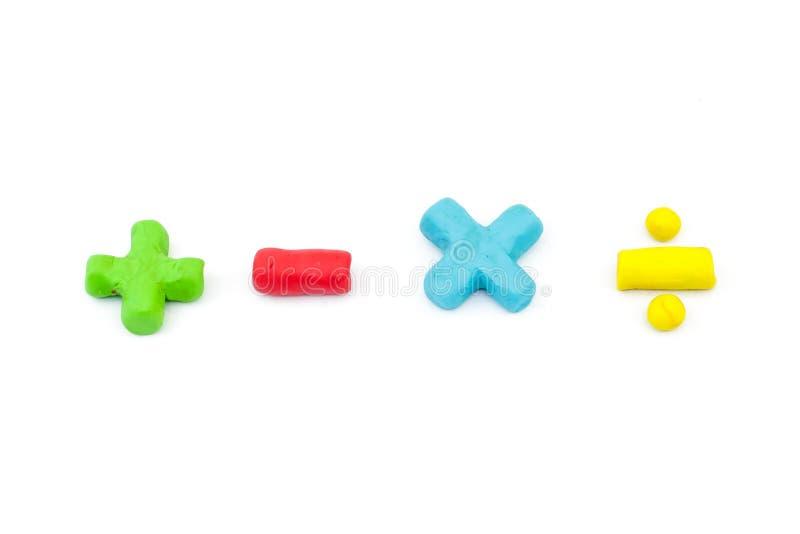 Symbole d'opérateur de maths de pâte à modeler (plus, sans, multiplication et image stock