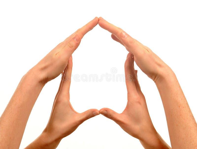 Symbole de Chambre avec des mains photographie stock