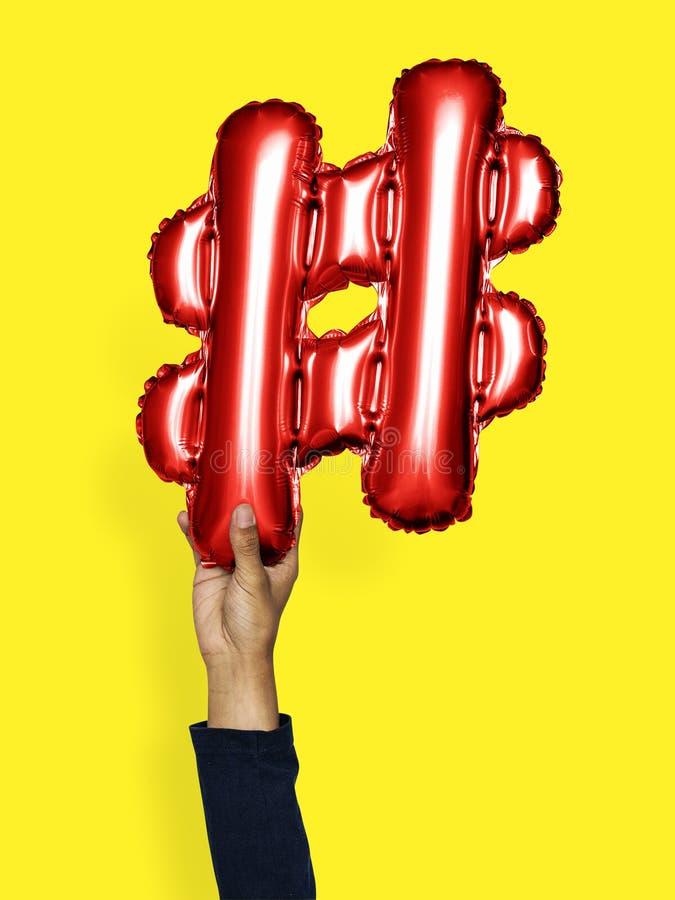 Symbole de hashtag de ballon de participation de main photos libres de droits
