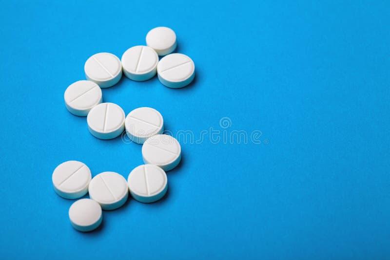 Symbole dollar présenté des comprimés blancs ronds image libre de droits