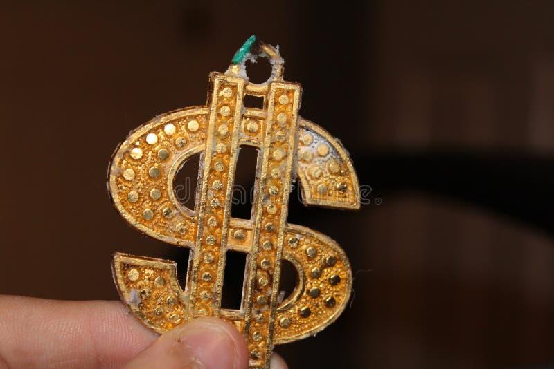 Symbole du dollar d'or images stock