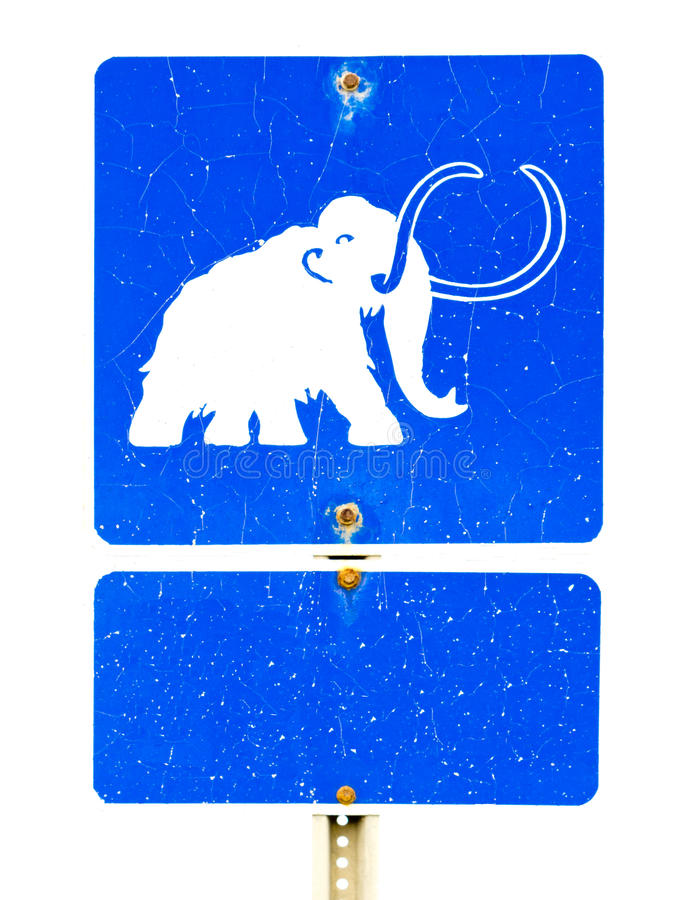 Symbole gigantesque drôle sur le signe de route photos libres de droits