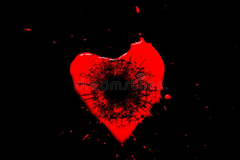 Symbole rouge de coeur divisé en petits éclats de verre d'un tir d'un pistolet avec un trou d'une balle d'isolement sur un noir photos libres de droits
