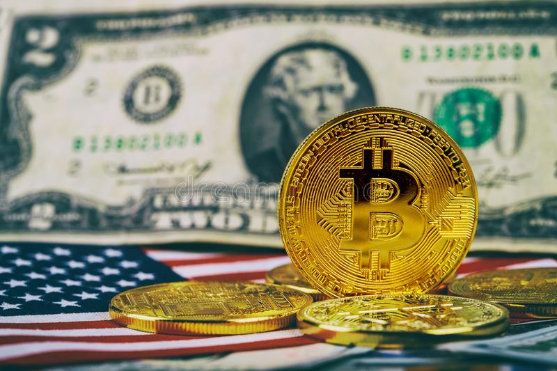 A symbolic coins of bitcoin on banknotes of one hundred dollars. bitcoin cash for a dollar. royalty free stock photography