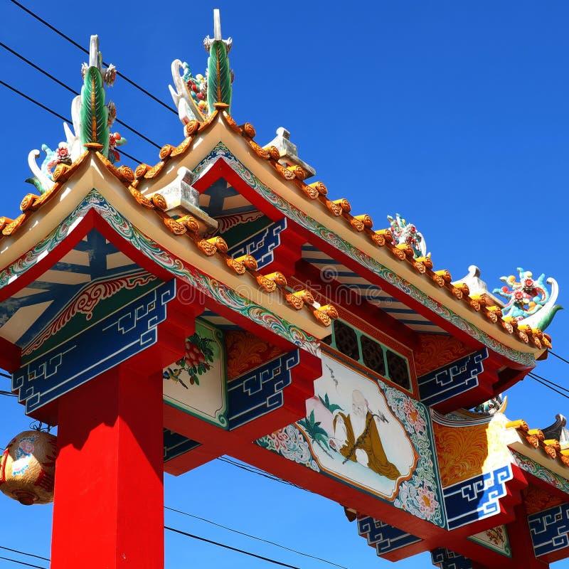 Symbolic gateway soaring into blue sky at Chinese shrine royalty free stock photo