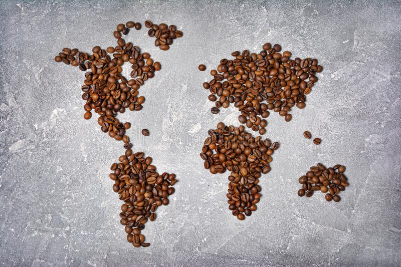 Symbolic image of world map made from roasted coffee beans stock image
