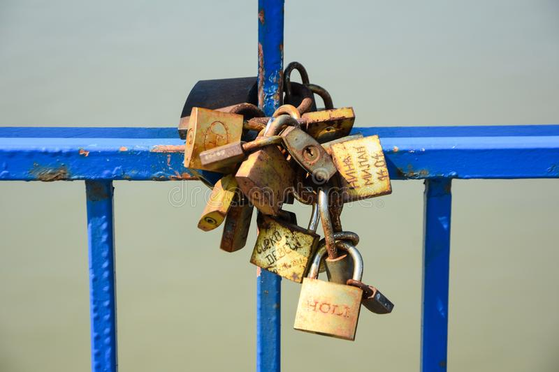 Symbolic love padlocks. padlocks on the bridge. Valentine royalty free stock image