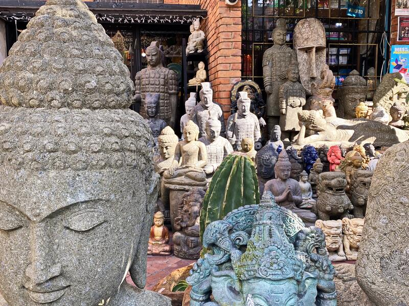 Collection of Buddha Statues and Spiritual Relics. Symbolic religious concrete statutes of Buddha and other ancient indian relics stock photography