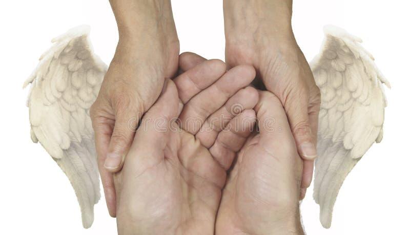 Symboliczne pomocne dłonie z aniołów skrzydłami obrazy royalty free