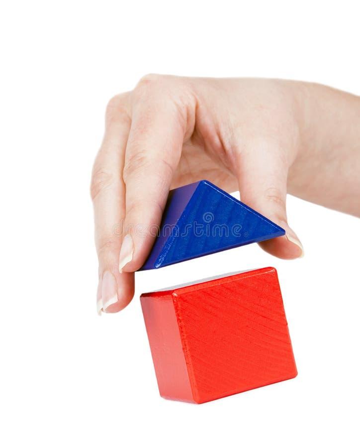 symbolicznie domowy ręki roofinto fotografia stock