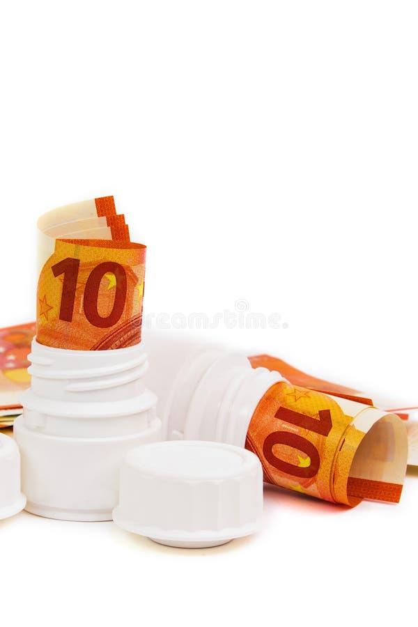 Symboliczny obrazek dla wysokość kosztu medycyna z pigułki butelką fotografia royalty free