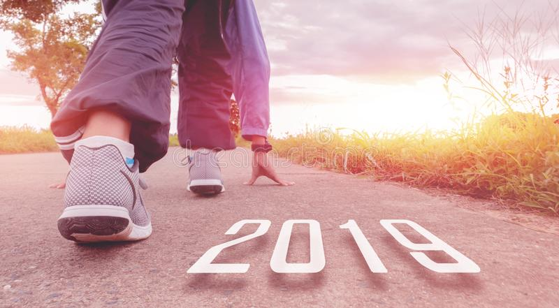 2019 symbolises the start into the new year.Start of people running on street,with sunset light.Goal of Success royalty free stock photography