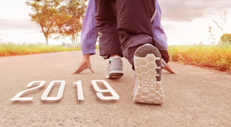 2019 symbolises the start into the new year.Start of people running on street,with sunset light.Goal of Success royalty free stock photo