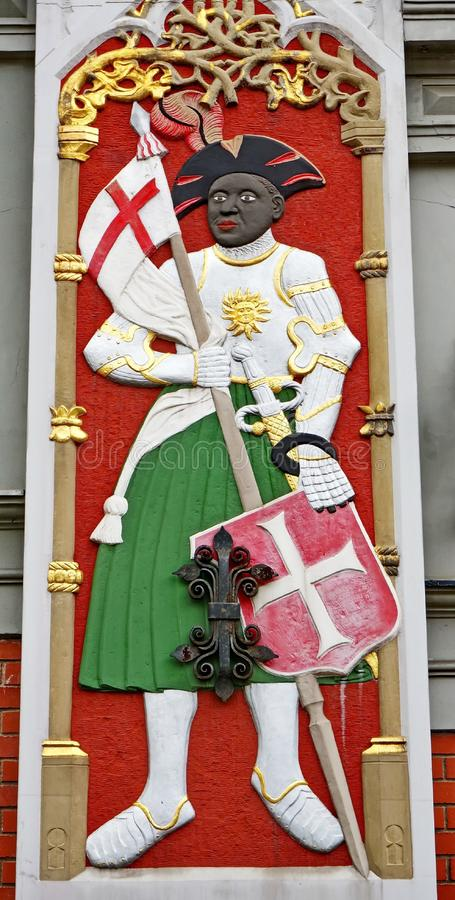 Symbolism of House of the Blackheads. St. Mauritius its symbol-the black head was in the coat of arms of the brotherhood royalty free stock images