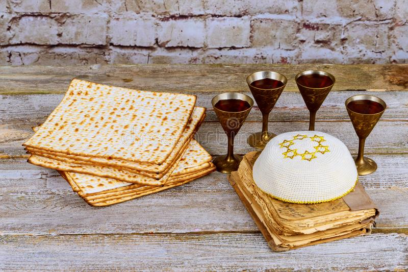 Passover background. wine and matzoh jewish holiday bread over wooden board. royalty free stock photos