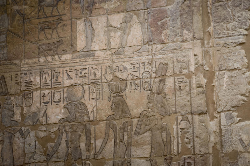 Symbols signs figures of the Pharaohs in Egypt, the wall in Luxor royalty free stock photo