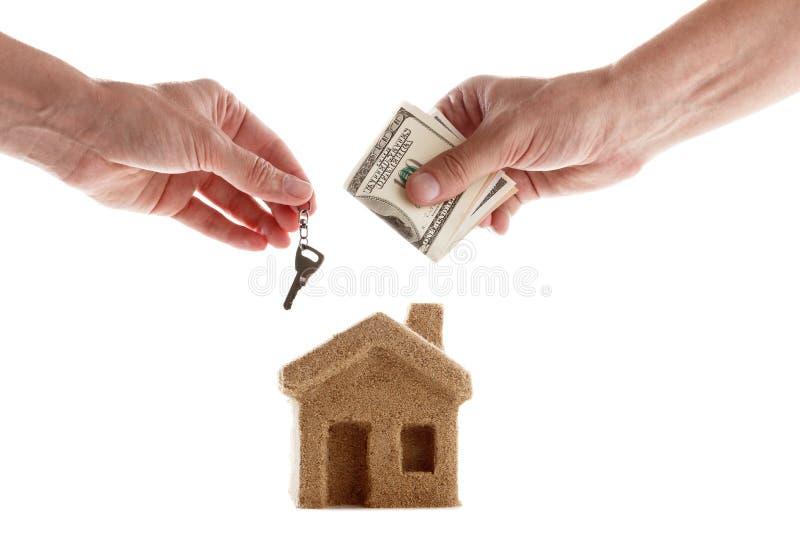 Symbool van de de huishuur en verkoop stock foto