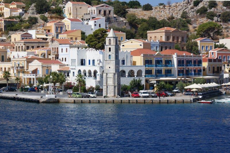 Ελλάδα, το νησί Symi Λιμάνι και Clocktower στοκ εικόνες